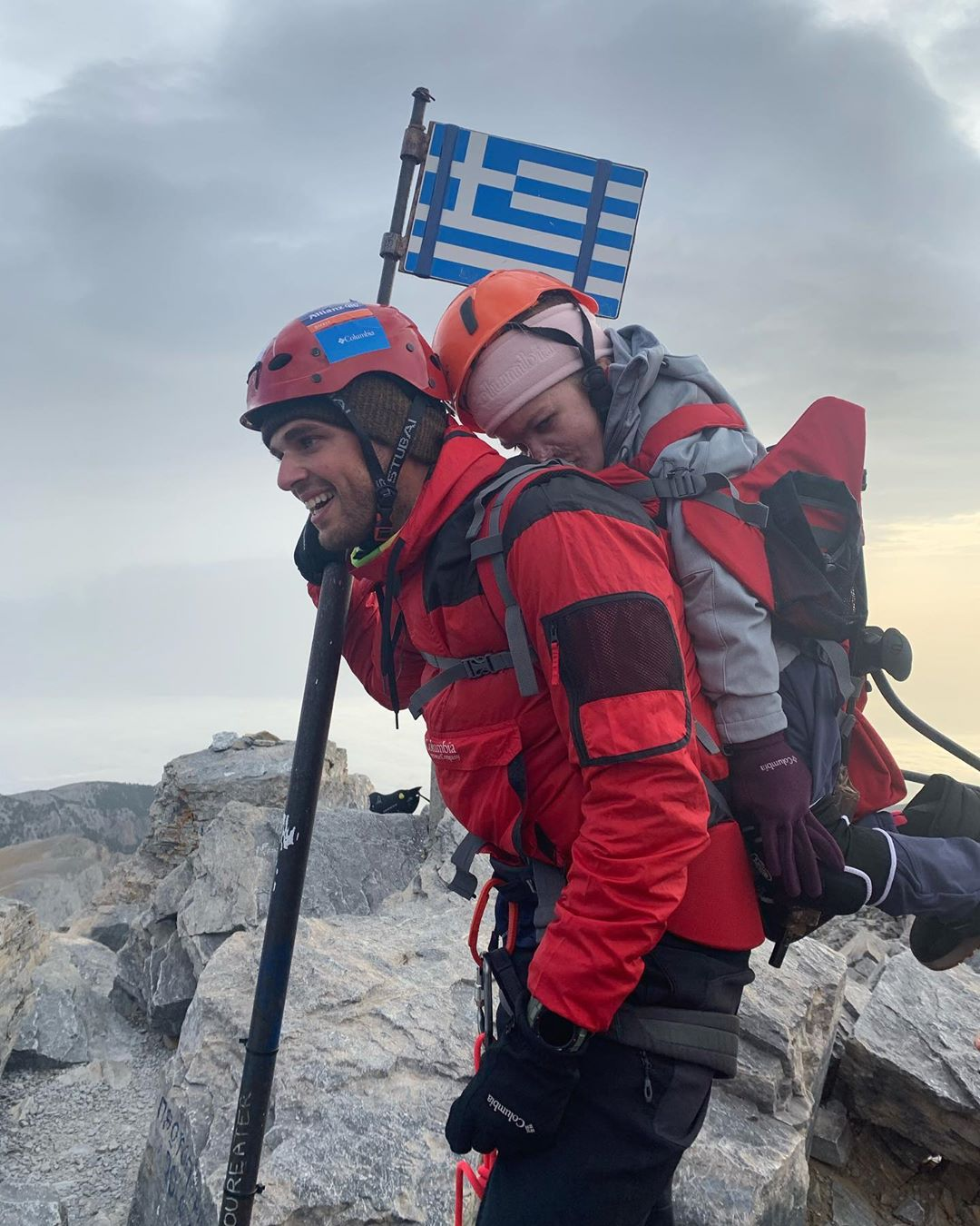 Greek Athlete Doing Good Carrying Disabled Woman Up Mount Olympus